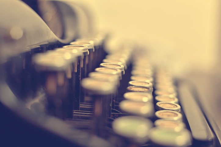 Old typewriter keyboard in vintage color tone